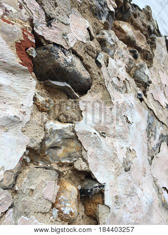 Close up of aging stone work and decaying plaster from a house built in 1700 in England poster