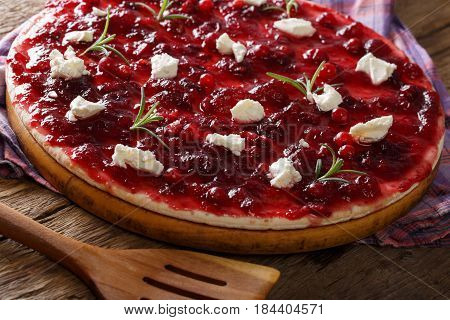 Freshly Baked Flatbread With Cranberry Sauce, Goat Cheese And Rosemary Close-up. Horizontal