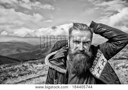 Brutal Man, Bearded Hipster In Winter Jacket At Mountain Outdoor