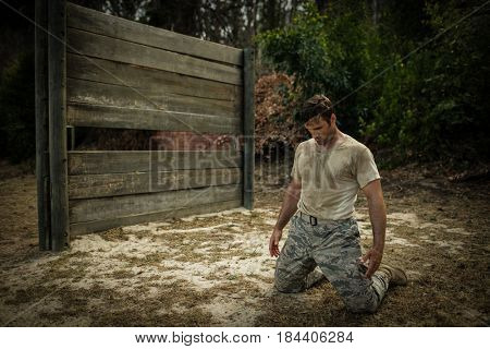 Soldier sitting on his knees in boot camp