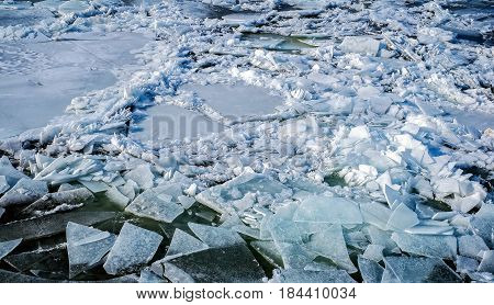 Ice floes in water, closeup view .