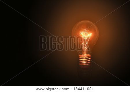 Light bulbs turn on on black background and no wiring with successful concept on thinking concept. Lighting in loft style or vintage style. Decorative antique edison style light bulbs and isolation.