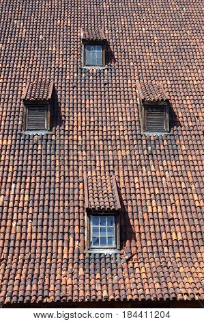 Old medieval roof with dormers in Gdansk, Poland.