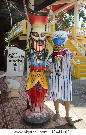 Asian Thai Woman Wearing Mask Head With Costume Of Phi Ta Khon Dance And Playing At Phi Ta Khon Muse