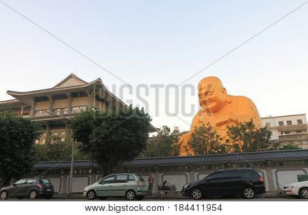TAICHUNG TAIWAN - DECEMBER 9, 2016: Unidentified people visit Bao Jue temple. Bao Jue temple is most famous for the presence of a giant smiling Buddha.