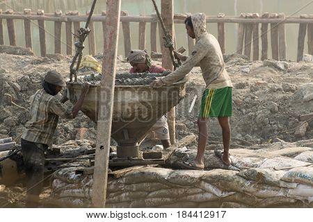 KOLKATA INDIA - APRIL 21 2017: Indian worker working at site. Piling work being done to support a superstructure. India is developing it's infrastructure.