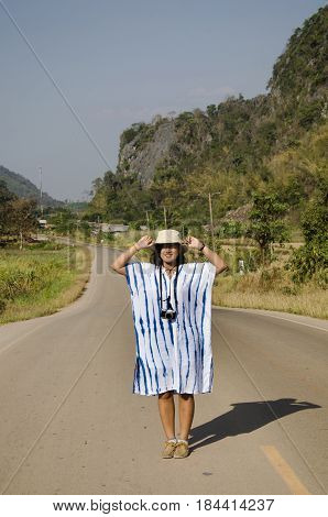 Thai Women People Travel And Posing On The Road Go To Suan Hin Pha Ngam Or Thailand's Kunming And Ph