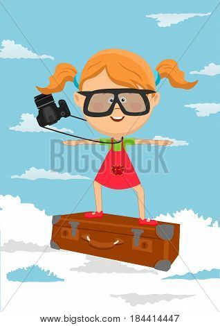 Cute little girl flying on a suitcase on background of blue sky