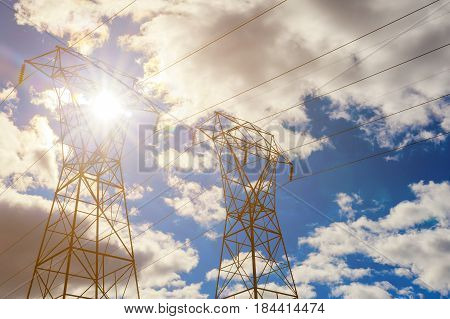 Electricity Pylon Overhead Power Line Transmission Tower At Sunset.