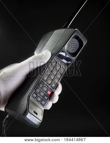 Oold original bulky brick type cell phone.