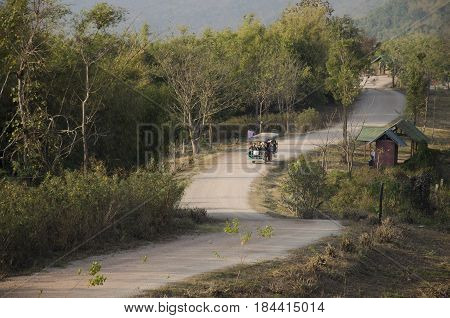 Thai people use tractor for service travelers tour Phu Pa Po mountain or Fuji City Loei on lateritic soil road go to at Phu Luang on February 22 2017 in Loei Thailand