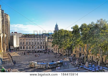 AVIGNON, FRANCE - SEPTEMBER 17 2015: The Popes Palace square in Avignon France UNESCO World Heritage Site on autumn sunny day