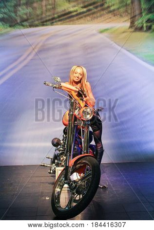 St. Petersburg Russia - 15 April, The girl at the motorcycle,15 April, 2017. International Motor Show IMIS-2017 in Expoforurum. Models on motorcycles presented at the motor show.