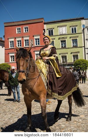 Tittmoning,Germany-April 30,2017: Woman riding a horse poses for the camera at the annual St.George's parade