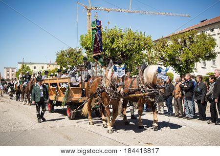 Tittmoning,Germany-April 30,2017: A carriage carrying a marching band at the annual St.George's parade