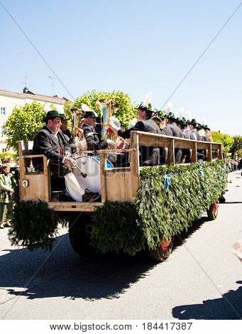 Tittmoning,Germany-April 30,2017: A carriage carrying a brass band at the annual St.George's parade