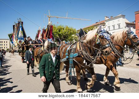 TittmoningGermany-April 302017: A horse carriage with banners at the annual St.George's parade