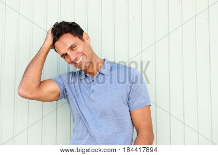Fashionable Older Man Smiling With Hand In Hair