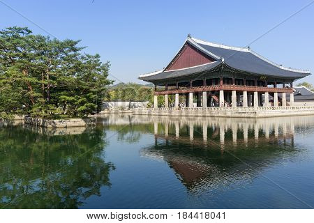 gyeonghoeru reflections. traditional korean palace pavilion in gyeongbok palace in seoul, south korea