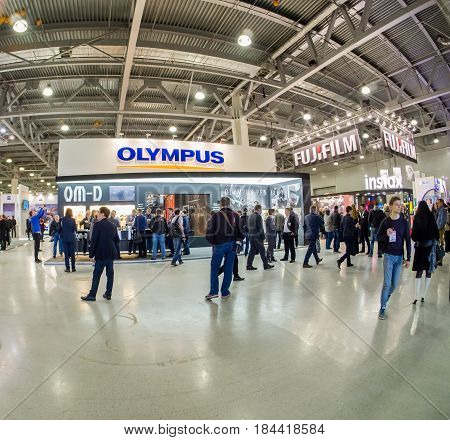 MOSCOW RUSSIA - APRIL 21 2017: Booth of Olympus company at PhotoForum 2017 trade show and exhibition in Moscow Russia on April 21 2017.