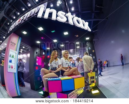 MOSCOW RUSSIA - APRIL 21 2017: Booth of Fujifilm company for promotion Instax cameras at PhotoForum 2017 trade show and exhibition in Moscow Russia on April 21 2017.