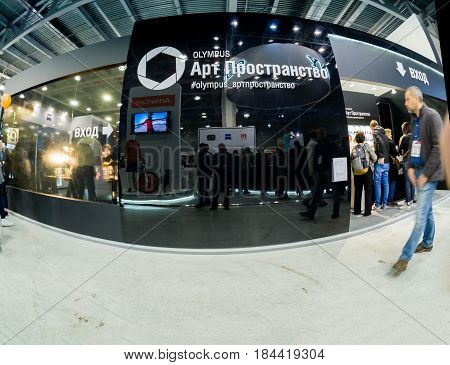 MOSCOW RUSSIA - APRIL 21 2017: Art Space booth of Olympus company at PhotoForum 2017 trade show and exhibition in Moscow Russia on April 21 2017.