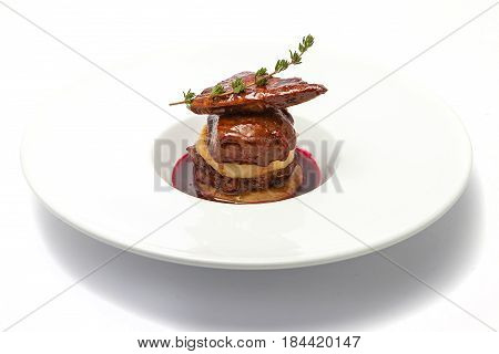 Duck liver with berry sauce and apples decorated with rosemary. Isolated