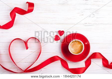 Valentines background with red heart and coffee cup. Valentines Day greeting card. Coffee break. Top view