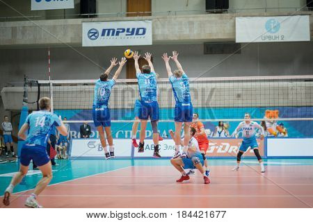 MOSCOW - NOV 5, 2016: Players jump at volleyball game Dynamo (Moscow) and Ural (Ufa) in Palace of Sports Dynamo