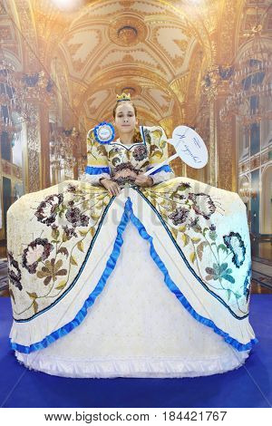 MOSCOW - DEC 4, 2016: Girl (with model release) poses in dress with cereals decoration at exhibition Foodshow in Sokolniki, text - i am queen, mistral