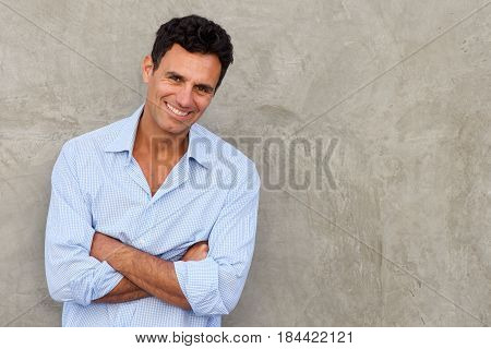 Handsome Mature Man Standing By Wall