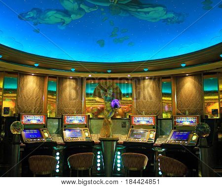 Cruise liner Vision of the Seas - May 7, 2017: Gaming slot machines in American gambling casino in the cruise liner Vision of the Seas of Royal Caribbean International, USA.