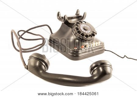 An old telephone isolated on white background