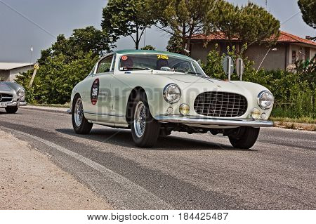 FORLI, ITALY - MAY 13: driver and co-driver on a vintage Italian car Ferrari 250 Europa GT (1955) in historical classic car race Mille Miglia on May 13, 2011 in Forli, Italy
