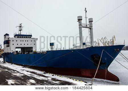 Dry cargo vessel in sea port in winter