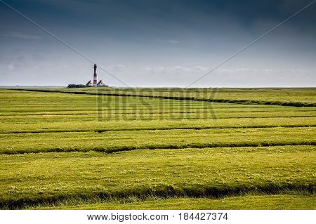 Beautiful Landscape With Famous Westerheversand Lighthouse In The Background At North Sea In Nordfri