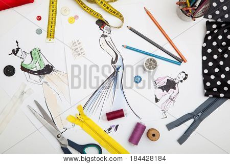 Fashion designer background of accessories and drawn picture of modern outfits