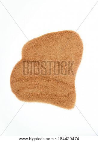 An abstract shape formed with a fine desert sand. Sand patch created on white background.