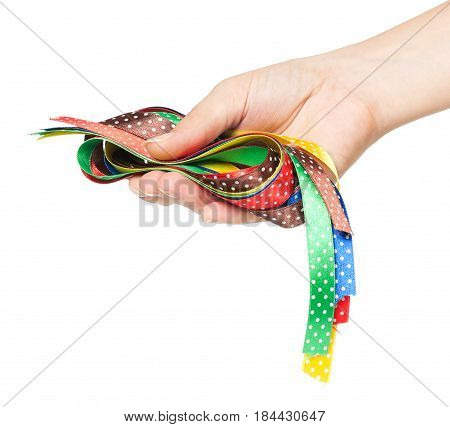 Colorful ribbons in a woman hand isolated on white background cutout