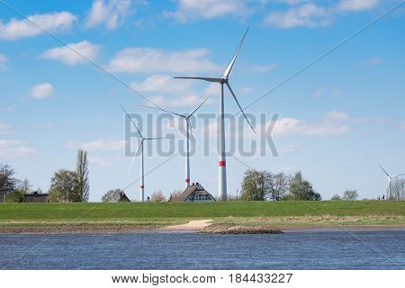Wind Turbines on the Elbe with Farm house in Germany Lower Saxony