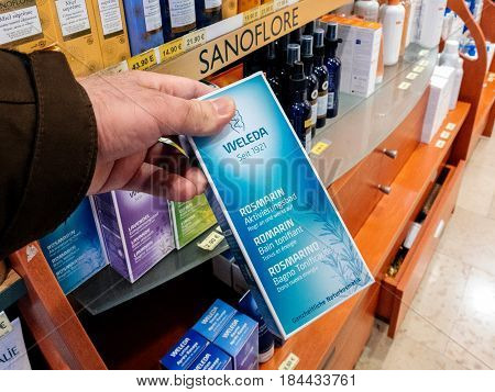 STRASBOURG FRANCE - APR 24 2017: Point of view of man buying Weleda Tonic bath gel in drug store pharmacy store shopping