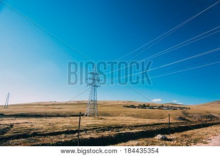 Electric Power Transmission Pylon On Inner Mongolia Grassland Against Blue Sky  ,china