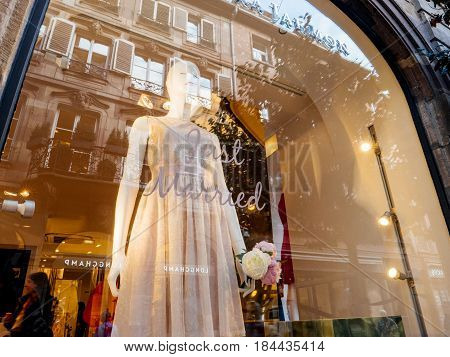 STRASBOURG FRANCE - APR 27 2017: Tara Jarmon fashion store boutique showroom in central French city with Just Married text tag and wedding dress in the show-window. Tara Jarmon is a Paris-based Canadian fashion designer.