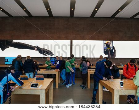 STRASBOURG FRANCE - APR 27 2017: Apple Store interior with customers testing diverse Apple Computers object - iPhone MacBook iMac Mac Pro and Apple Watch