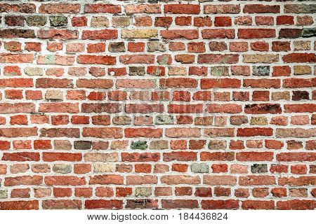 Pattern of red stone blocks. Brickwall texture close up view. Wall of red small bricks.