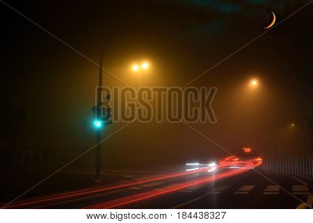 Fog and moon on the streets of Brescia - Lombardy - Italy