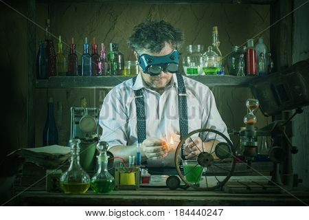 crazy medieval scientist working in his laboratory