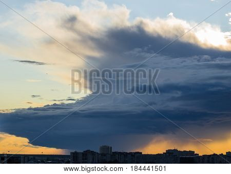 Stormy Supercell Weather Over The City At Sunset.