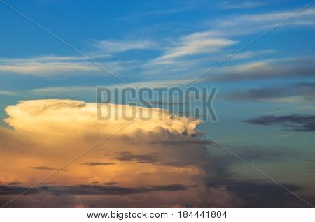 Supercell Thunderstorm Sunset And The Blue Sky And Cirrus Clouds.