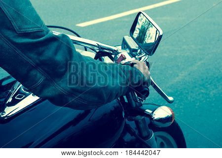The Hand On The Gas Of A Motorcycle On The Road